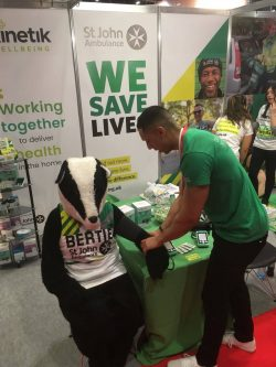 Kinetik's Chris checks Bertie the Badger's Blood Pressure