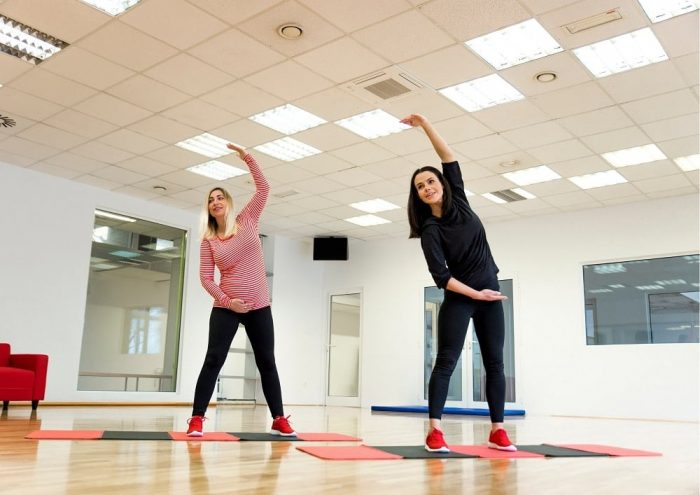 Aerobics class with pregnant woman